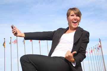 enthusiastic business woman with mobile phone