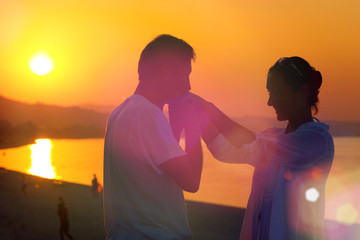 Romantic marriage proposal on the sea shore