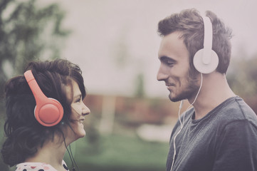 Boy and girll listening to music on headphones