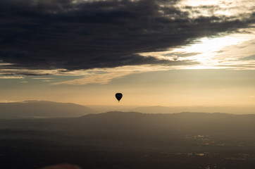 Silhouette of hot air balloon over Melbourne