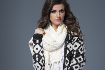 Portrait of beautiful woman in warm clothes.