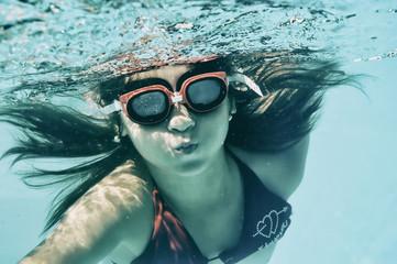Little girl swimming underwater in sea