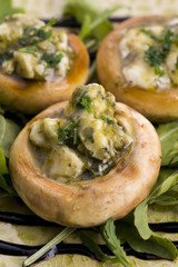 Delicious stuffed mushrooms with cheese and pesto