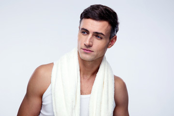Handsome man looking away over gray background