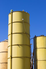 three silos yellow