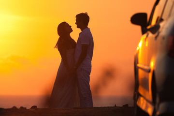 Sunset background of silhouette couple