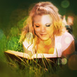Attractive young woman reading book