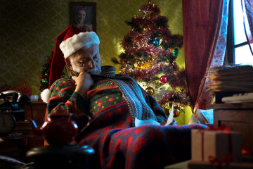 Santa Claus napping on his armchair