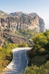 Road running under monasteries build on sandstone ridge