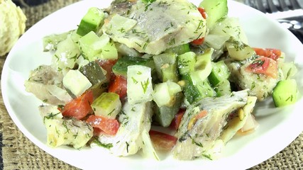 Portion of rotating Herring Salad as not loopable 4K UHD footage