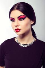 Fashion model portrait. Scarlet makeup. Black arrows.