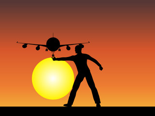 Man silhouette with plane at sunset