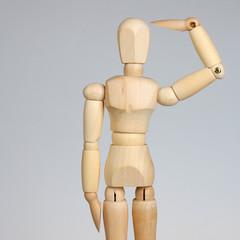 Wooden mannequin saluting