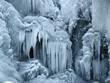 Leinwanddruck Bild - A frozen waterfall with ice in winter