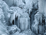 A frozen waterfall with ice in winter