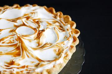Classic american pumpkin pie with burned meringue