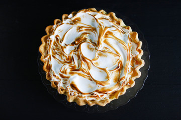 Pie cake with burned meringue cream top, pattern, isolated