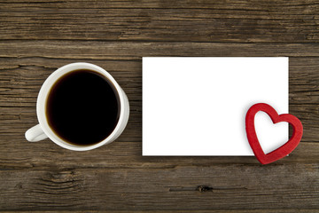 cup of coffee and paper sheet with a heart