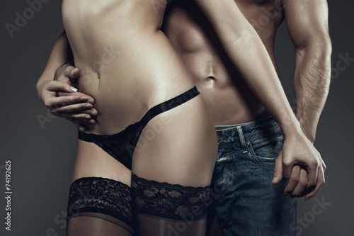 canvas print picture Sexy young couple holding hands at night