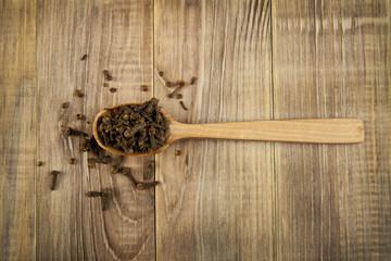 seasoning of carnation in a spoon