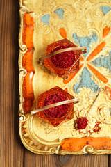 saffron spice in antique vintage glass bowl, closeup