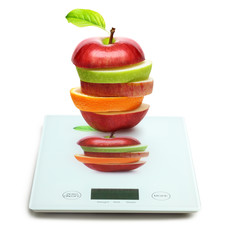 Fruits on digital weight scale