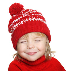 Happy little boy in red hat and sweater
