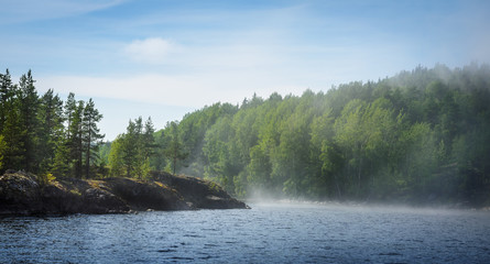 lake, forests and haze over the water