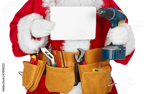 Leinwanddruck Bild Santa Claus with a tool belt.