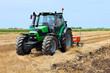 Leinwandbild Motiv Tractor on the farmland