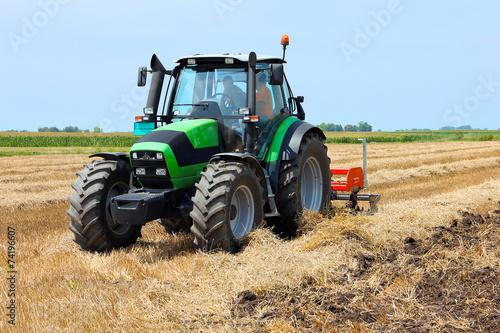 Tractor on the farmland - 74196607