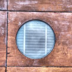 porthole in the wood