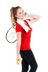 Young girl tennis player resting after a workout.