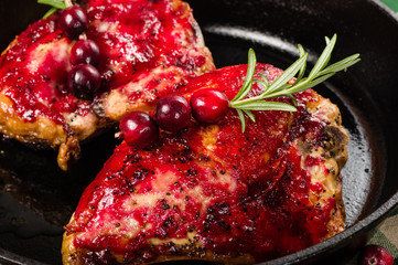 Two cranberry glazed chicken breasts