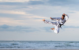 Man jumping to practice Marcial Arts kick