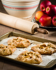 Baking tray and rolling pin with tarts