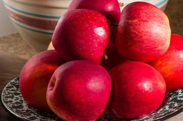 Bowl of freshly picked red apples