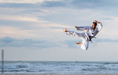 Foto op Canvas Vechtsport Man jumping to practice Marcial Arts kick