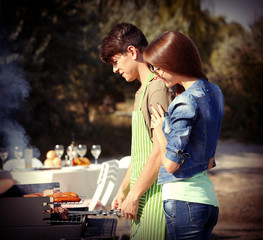 Beautiful couple having barbecue party, outdoors