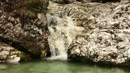 Small creek and waterfall in Slovenia hills with clean water