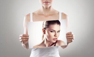 Beauty and healthcare concept. Female holding fashion portrait