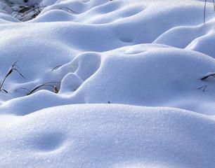 Snow drifts in snowbound winter meadow