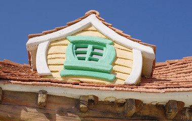 Roof window of fairy tale house in children's park
