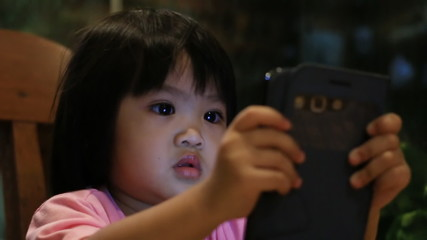 Baby playing with Smart phone