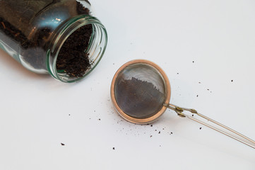 Filled tea infuser and a felt down tea jar