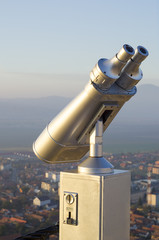coin operated high powered binoculars on a hill