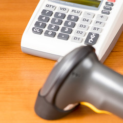 Cash register with barcode scanner against the background