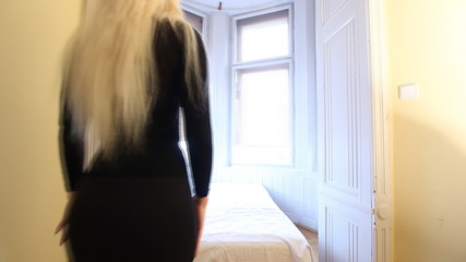 Slow motion sexy Czech woman crawls on bed