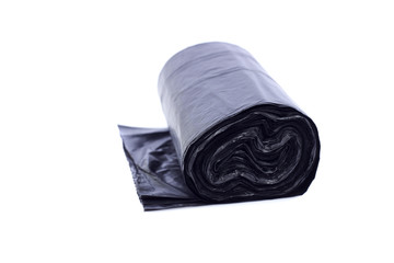 Roll of black plastic trash bags, isolated on white