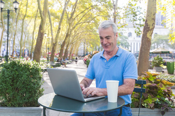 American Senior Man with Computer at Park